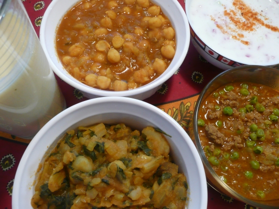 From top left: mango lassi, chana masala, raita, potato and swiss chard curry, keema curry